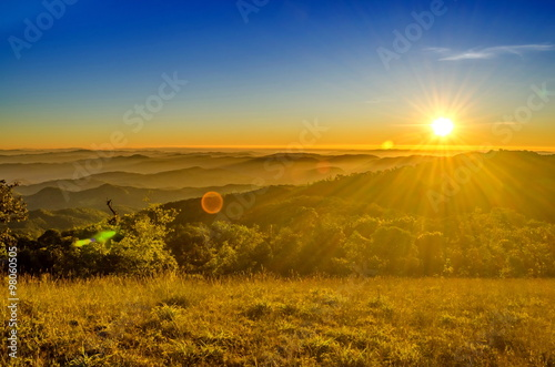 Deurstickers Ochtendgloren sunrise in the mountains landscape