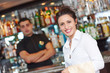 canvas print picture - young waitress at service in restaurant