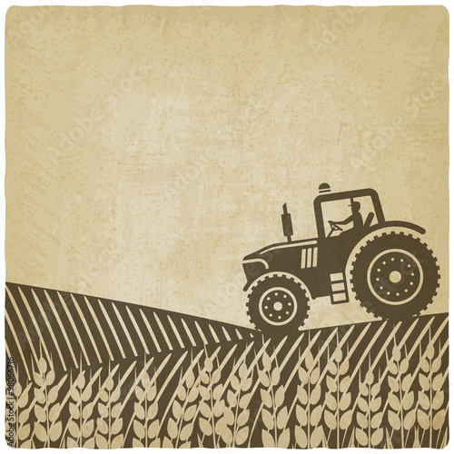 Fotografering  tractor in field old background