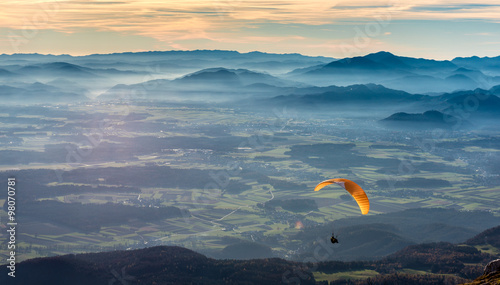 Fotobehang Luchtsport Paraglider is flying in the valley