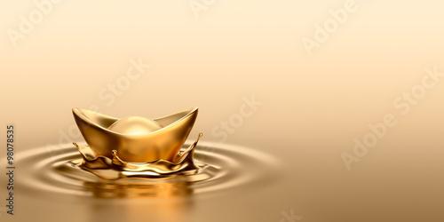 Photo  Gold Sycee (Yuanbao) drop on liquid gold