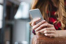 Close Up Of Smartphone Used By Young Blonde Woman