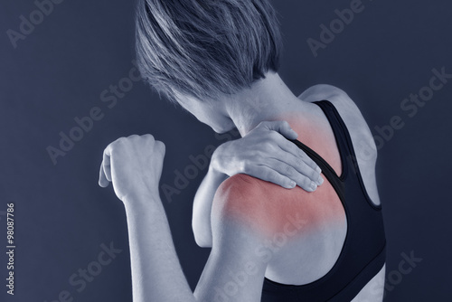 Closeup of fitness girl with shoulder pain, isolated Canvas Print