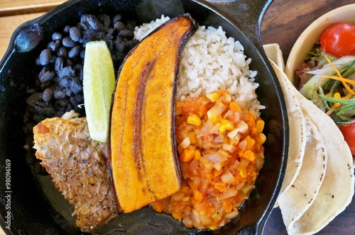 Obraz na plátne Traditional Costa Rican Casado meal with rice, beans and plantains