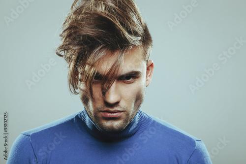 Fotografie, Obraz  Handsome man with modern hairstyle in studio