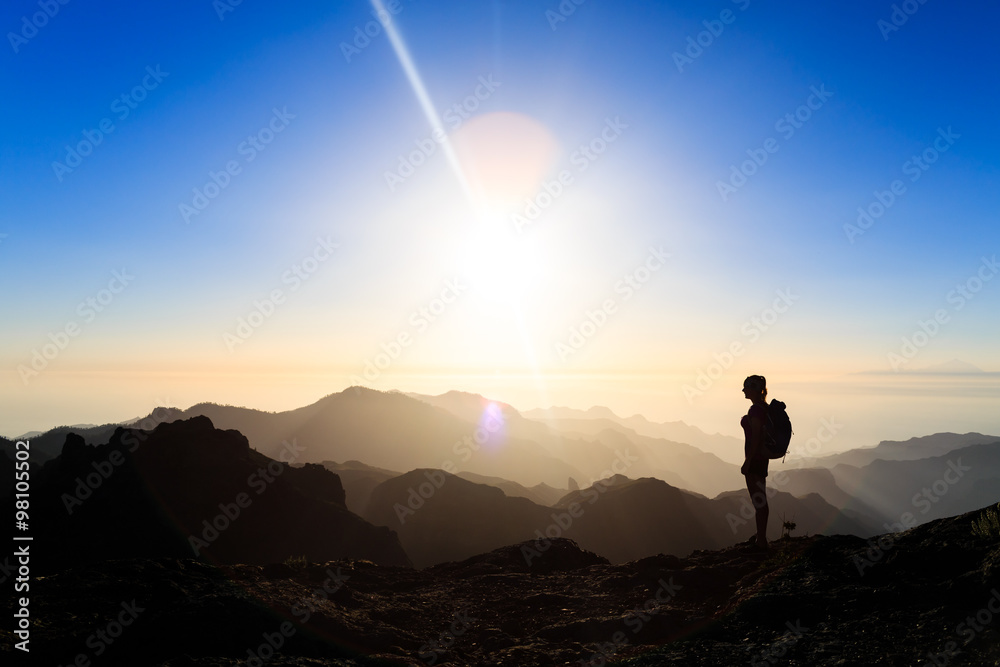 Fototapety, obrazy: Woman hiking success silhouette in mountains sunset