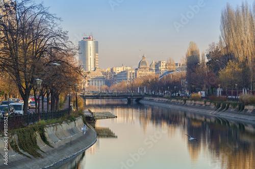 Cityscape from Bucharest with Dambovita River in sunset light