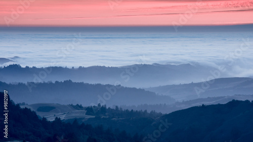 Foggy Rolling Hills Sunset. Russian Ridge OPen Space Preserve, San Mateo County, California, USA.