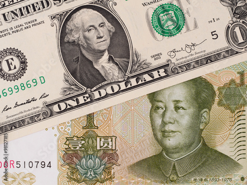 Us Dollar And Chinese Yuan Banknotes Currency Exchange Money Closeup