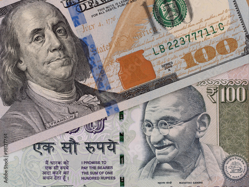 Us Dollar And Indian Ru Banknotes Currency Exchange Money Closeup