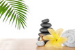 Spa stones with candle, towel and lily, isolated on white