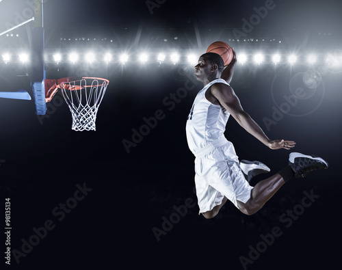 Basketball Player scoring a slam dunk basket Fotobehang