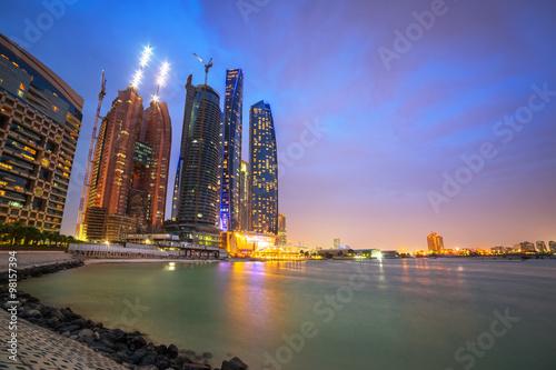 Poster Abou Dabi Skyscrapers of Abu Dhabi at night, United Arab Emirates