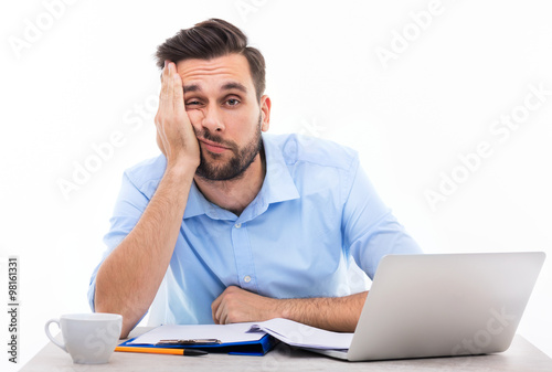Fotografie, Obraz  Bored young man at the desk