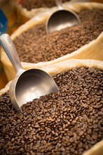 Barrels Of Fresh Coffee Beans And Scoop In Gourmet Specialty Market