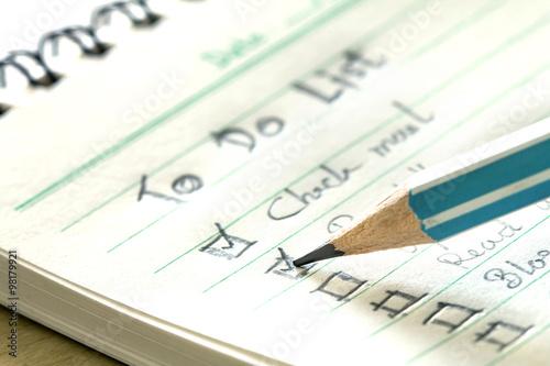 Fotografie, Obraz  close up pencil checking on Handwritten to do list plan