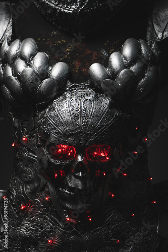 Photo  Dark silver armor skull with red eyes and led lights, helmet met