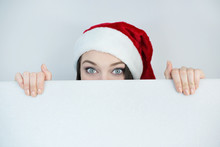 Santa Girl Holding White Empty...