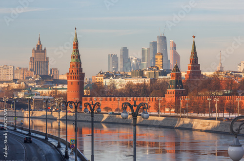 Moscow winter morning. View from Moscow River bridge on the river and the Kremlin, in the direction of high-rise buildings Ministry of Foreign Affairs and skyscrapers of Moscow-City - 98203561
