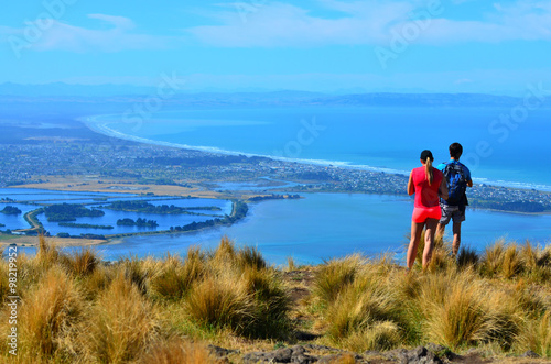 Tourist couple look at the landscape view of Christchurch - New