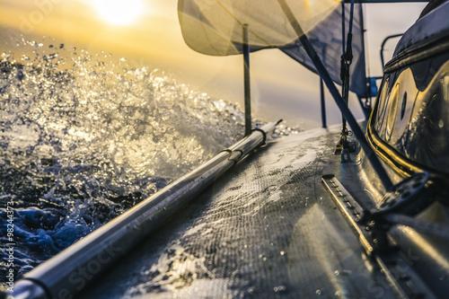 Staande foto Zeilen Sailboat going fast during sunset