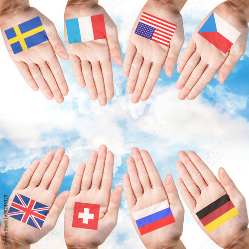 Fényképezés  Woman hands with countries flags