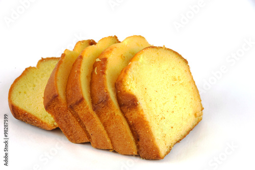 Photographie sliced sponge cake on white background