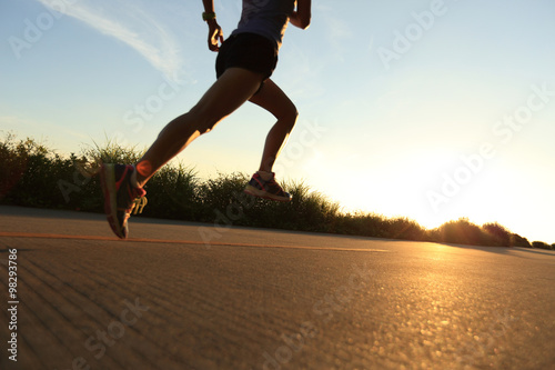 Poster Glisse hiver defocused young fitness woman running on sunrise seaside trail