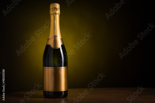 Fotografie, Obraz  bottle of champagne with blank golden label