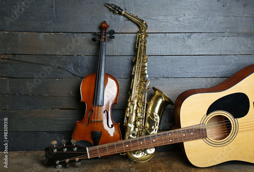 Musical instruments on wooden background - 98309318