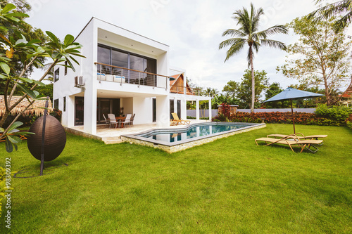 Fotografiet Luxury villa with swimming pool outside exterior view