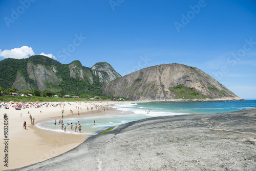 Bright view of Itacoatiara Beach from the dramatic rocks of the sea-facing beach Canvas Print