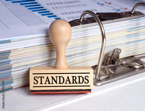 Standards rubber stamp with binder in the office Fototapete