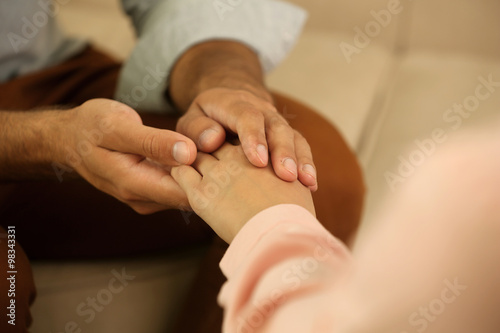 Fototapety, obrazy: Concept of support - man and woman holding hands in the light room