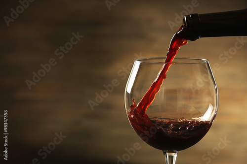 Fotografie, Obraz  Red wine pouring in a glass