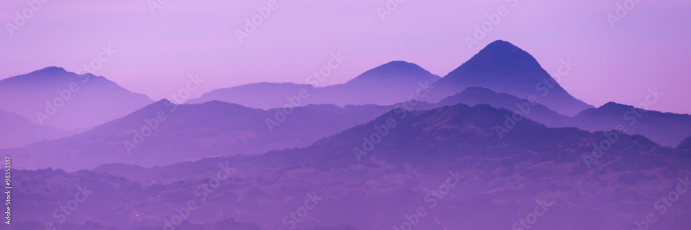 Fototapety, obrazy: Skyscape of cold purple mountains with mist and fog close to Quetzaltenango