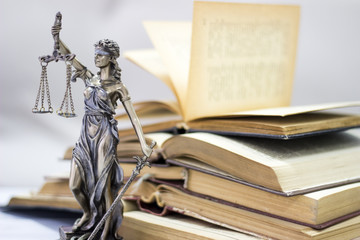 Naklejka Law concept, statue and books