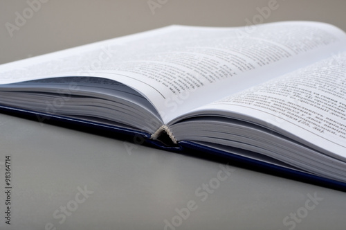 Fotografie, Tablou Closeup open book on a gray table