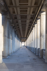FototapetaA long corridor between many columns in a historical building in berlin