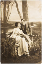 Young Romantic Couple Of Woman And Man In Spring Garden