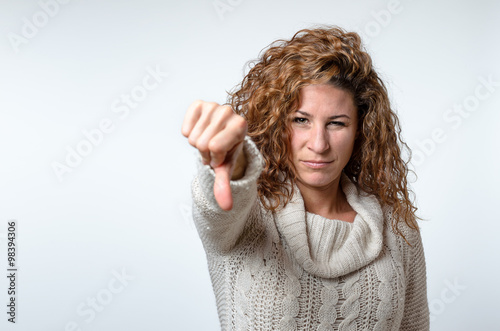 Fotografia, Obraz  Young woman giving a thumb down gesture
