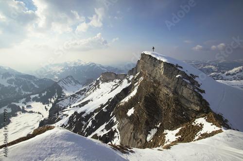 Austria, Kleinwalsertal, Man skiing in Alps