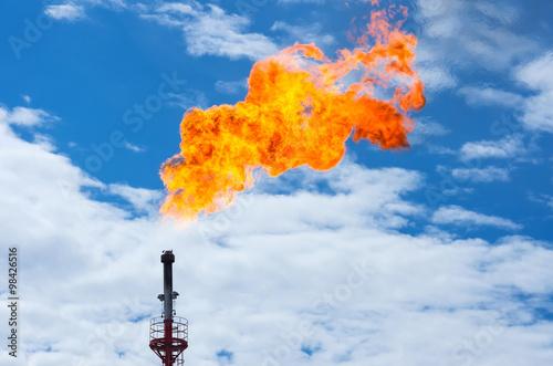 Valokuvatapetti Gas flaring. Torch against the sky.