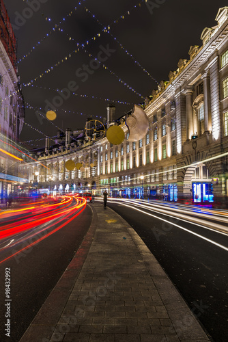Photo  Regent Street Christmas lights and decorations at night, London UK