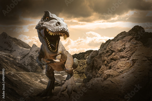 Obraz na plátne Dinosaurs model on rock mountain background