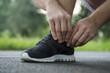 Running man tying shoelaces