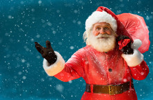 Real Santa Claus, Carrying Big Bag Full Of Gifts To Children /  Merry Christmas & New Year's Eve Concept / Closeup On Blurred Blue Background.