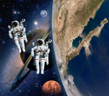 Two astronauts spaceman solar system saturn mars planet moon sci fi space. Elements of this image furnished by NASA. - 98498137