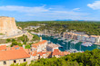 A view of Bonifacio port with colorful houses and boats, Corsica island, France.
