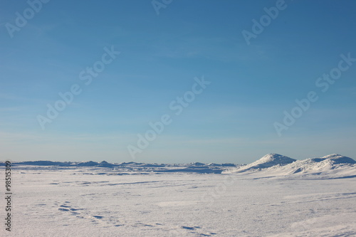 Staande foto Bleke violet the Arctic landscape. snow plain and sky